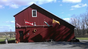 OTHER_Wine_Barn_With_Flags-337x190